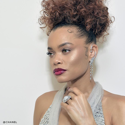 Andra Day with leaves cascade diamond drop earrings