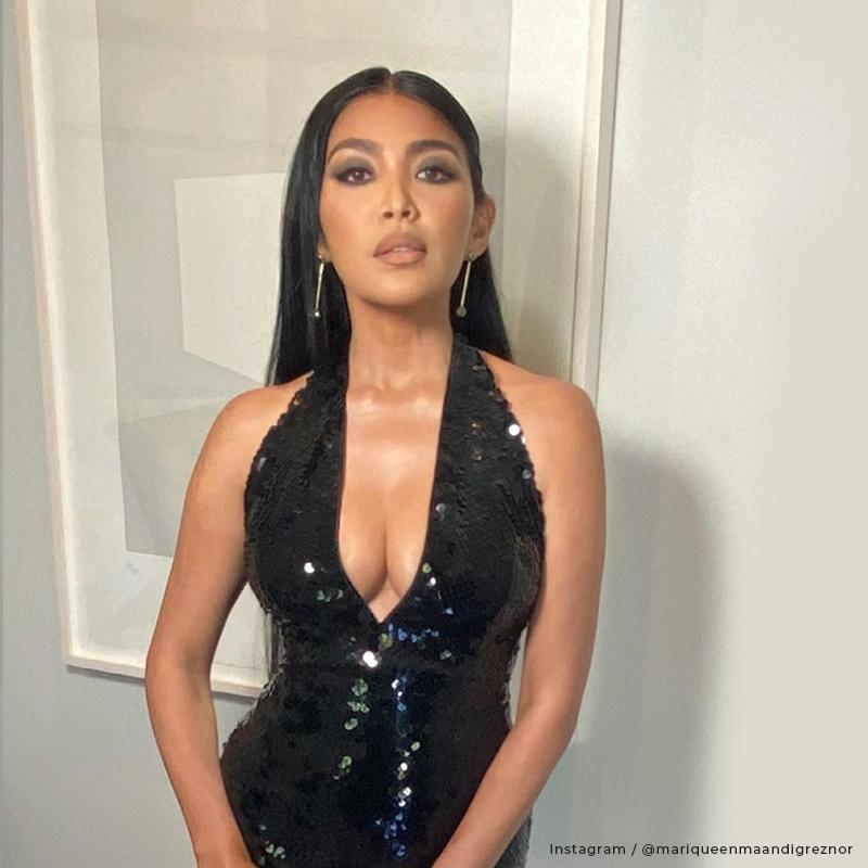 Mariqueen Maandig Reznor wearing a black dress