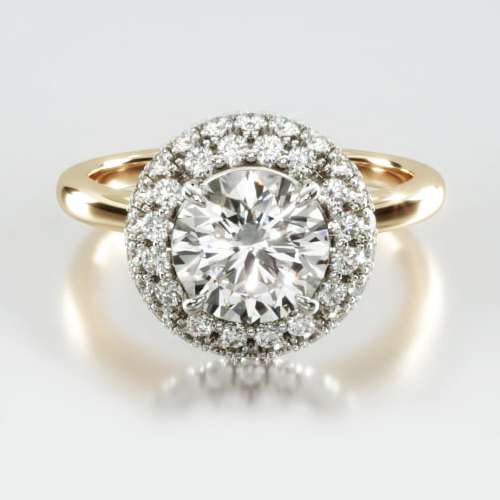 Solitaire Engagement Ring Embellished With a Falling Edge Pavé Halo Head