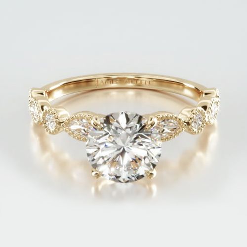 Round & Marquise Shape Diamond Engagement Ring Embellished With a Four Prong Signature Head With Diamond Bridge Accent