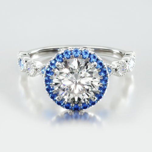 Round Diamond & Sapphire Marquise Shape Engagement Ring Embellished With a Single Row Sapphire Pavé Halo Head