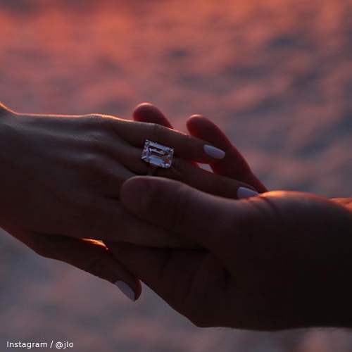 A-Rod holding Jennifer's hand as they both show off her emerald-cut diamond engagement ring