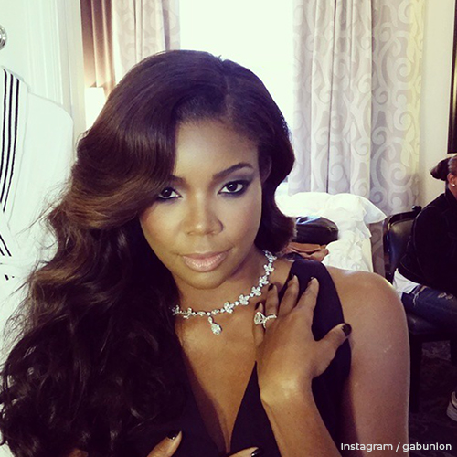Gabrielle wearing her diamond engagement ring along with a large diamond necklace.