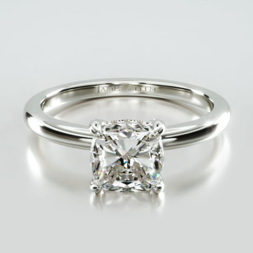 Solitaire Engagement Ring Embellished With a Classic Pavé Basket Head.