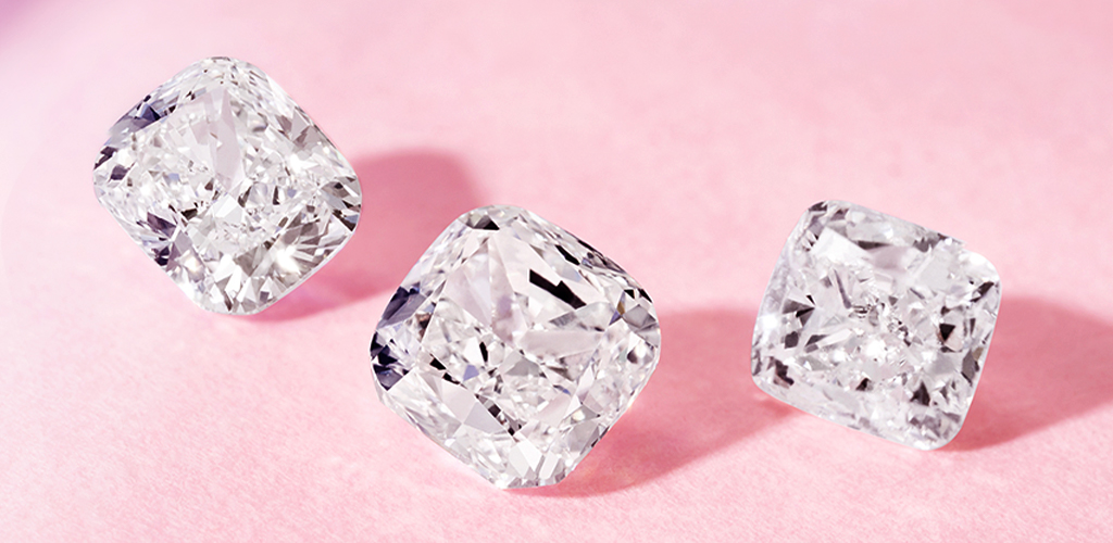 Three cushion cut diamonds shown from different angles.