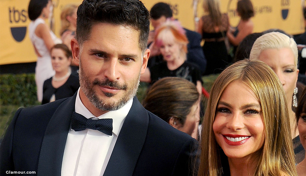 Sofia smiling with her husband Joe on the red carpet.