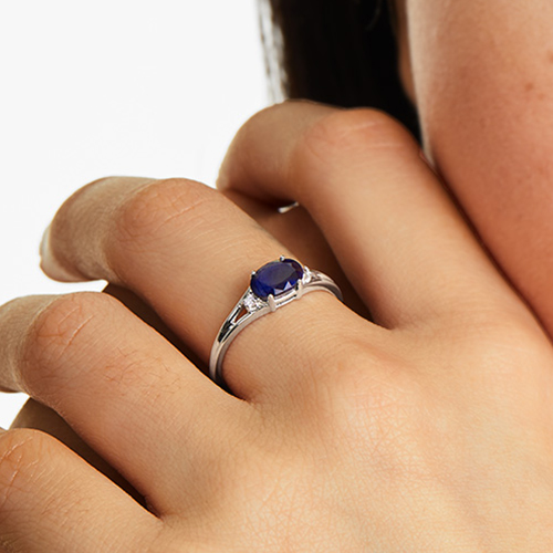 14K White Gold Oval Sapphire And Diamond Accent Birthstone Ring