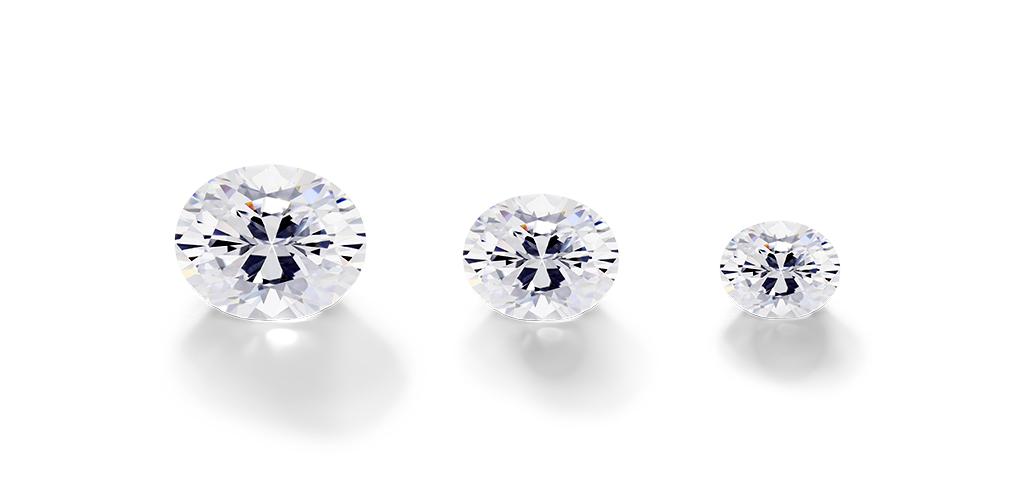 Three different sized oval cut diamonds